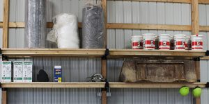 supplies stored on post rack