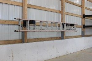 Ladder storage on post-rack brackets